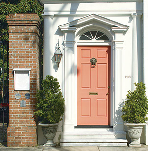 The orange paint used on this city home's front door features Gennex® Color Technology.