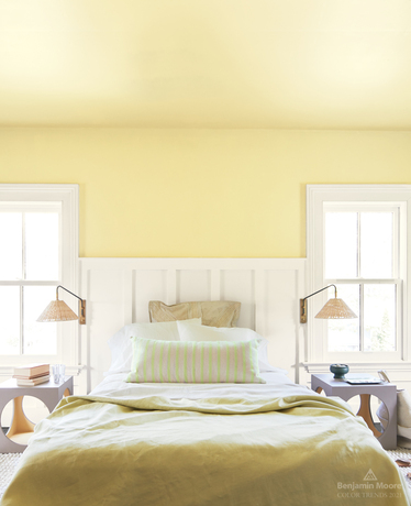 A bedroom in Beacon Hill Damask HC-2 with trim and wainscotting painted in Atrium White OC-145.